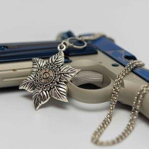 Low hanging floral bullet necklace